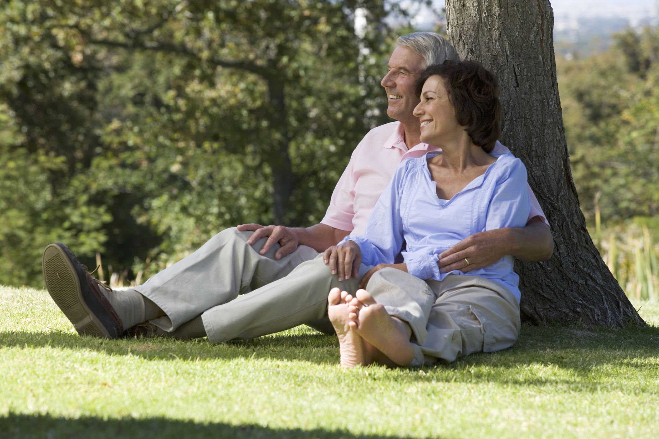 Senior couple sitting under a tree